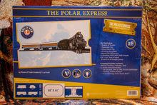 "Load image into Gallery viewer, The Polar Express-Lionel battery operated train, featuring authentic sound clips from the movie.  Set includes: Engine & tender, passenger car, observation car, sound on/off switch, 3 position FWD/OFF/REV/ switch, 40"" x 63.5"" loop track, 8 curve &16 straight pieces in box"