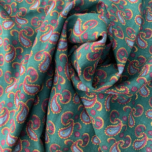Bottle green background with paisley print, wool blend, Vintage deadstock from Our Social Fabric.
