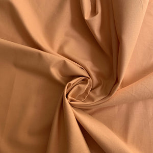 Peach colour 100% cotton, soft hand. Not stretch and not see-through.