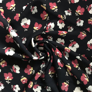 Flowy woven crepe with cute floral print, black background. Nice hand, soft touch, not stretch and not see-through. This fabric does not wrinkle! 100% rayon