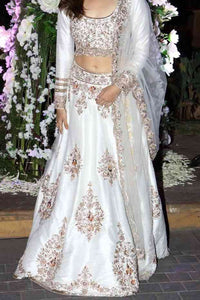 Shine White Colored Partywear Designer Embroidered Tapeta Silk Lehenga Choli