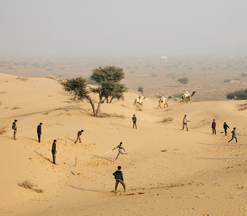 Locals playing a game of cricket in the sandunes.