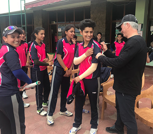 Steve Waugh signing the shirt of a local cricket team in India