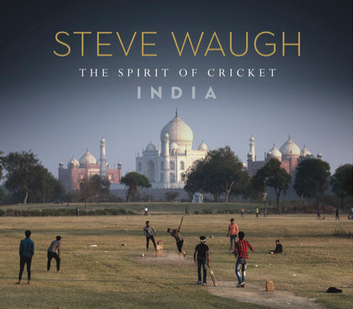 Book cover of the Steve Waugh, Spirit of Cricket in India Book. Cover image of locals playing on grasslands outside the Taj Mahal