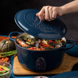 Enameled cast iron Dutch oven blue chef use from side