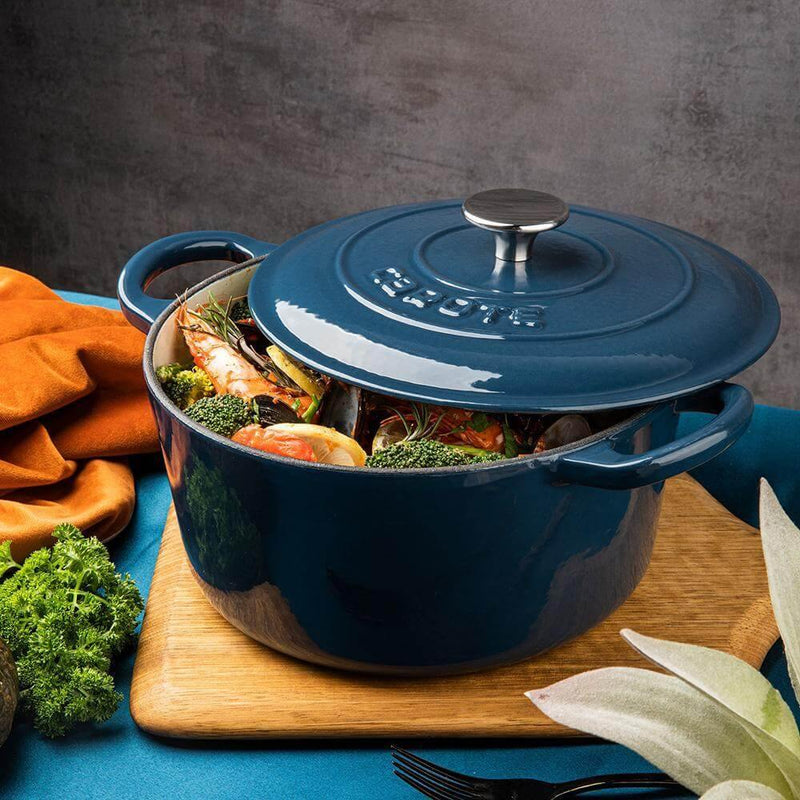 Enameled cast iron Dutch oven blue color with food