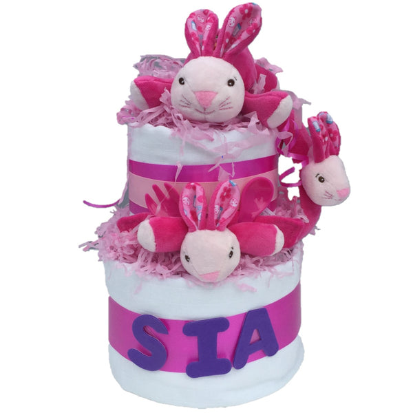 Personalise bunny nappy cake, personalised nappy cake, personalised pink nappy cake, personalised nappy cake for a girl, bunny nappy cake, pink bunny nappy cake, baby gift for a girl, pink baby gift, nappycakes.ie