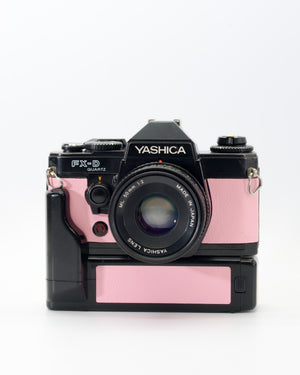 PINK Yashica FX-D 35mm SLR film camera with motor drive and 50mm f2 lens