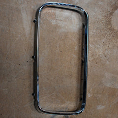 Imperial Crown LH headlight bezel 1965 only