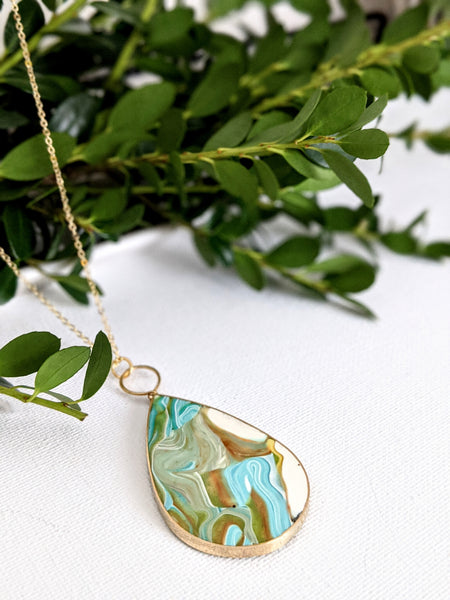 Swirling Marbled Sky Brass Necklace