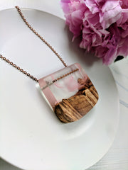 Wood and Resin Necklace. Clear and pink colored resin.