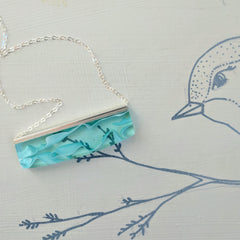 Light Blue Ribboned Resin Necklace with Silver Filled Chain