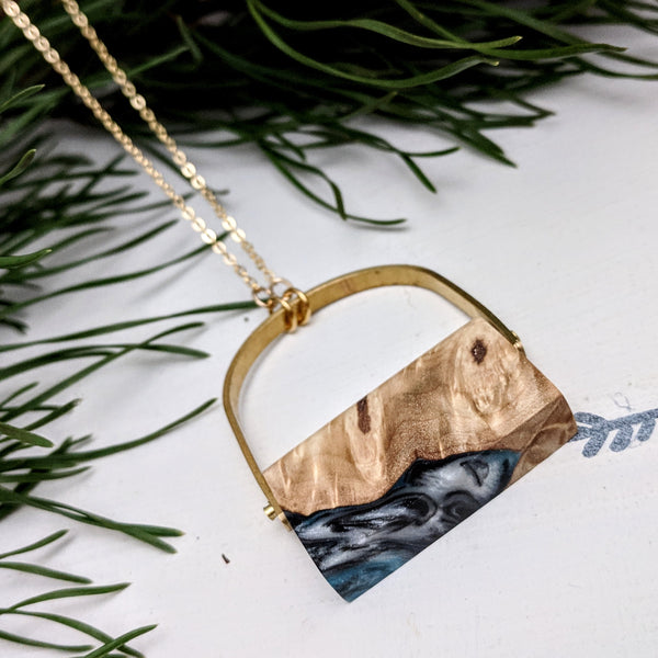 Blue Swirls and Wood Pendant with Brass Arch
