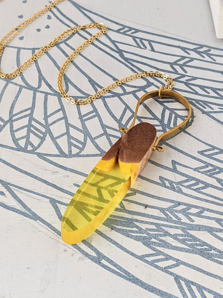 Summer Breeze Wood and Resin Pendant With Brass Arch