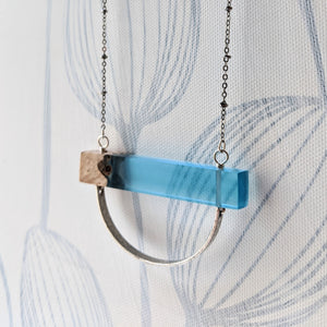 Wood And Blue Resin Necklace With Silver Arch