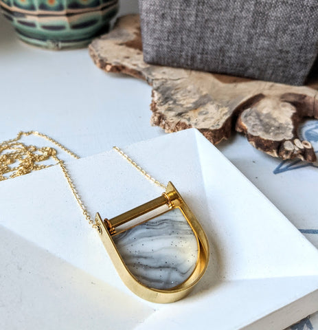 Marbled Tunnel Swinging Brass and Resin Necklace