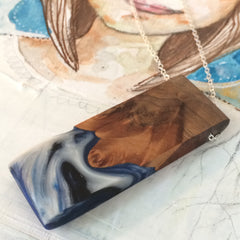 Wood and Resin Pendant. Black Blue and White Swirls