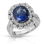 Natural Blue Sapphire 4.43 Carats Set in 18K White Gold and Diamond Ring