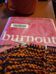 Knitting in progress on a book