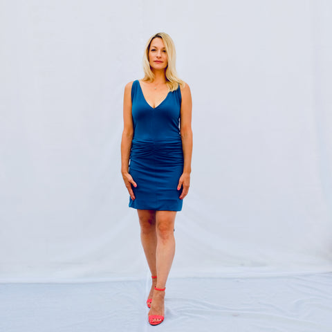 Blue fitted sleeveless short dress (front view)