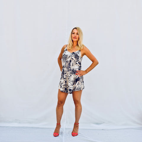 Summer palm printed romper with a tank top and flowing shorts (front view)