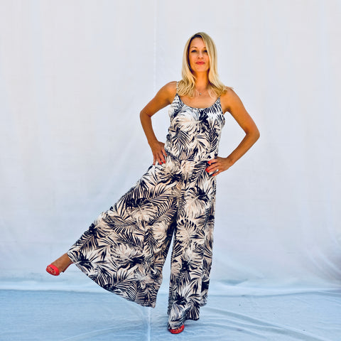 Summer palm printed jumpsuit with a tank top and flowing pants (front view)