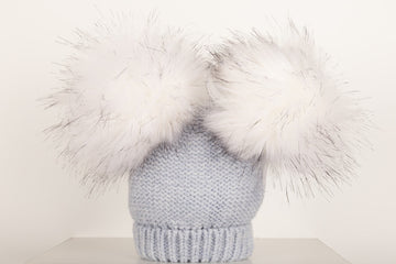 Woollen knitted double pom pom hat