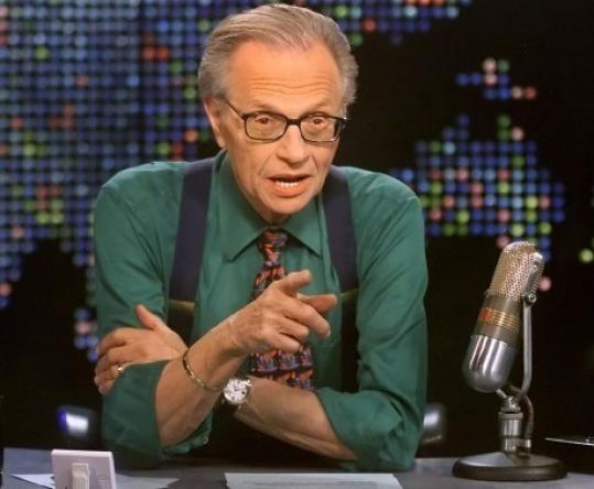 Larry King, the famous American news anchor, wearing braces.