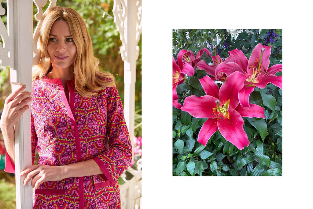 A beautiful blonde haired lady wearing an ornate luxury pink silk jacket.
