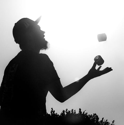 Black and white photo of Klaus juggling with Feel Flux