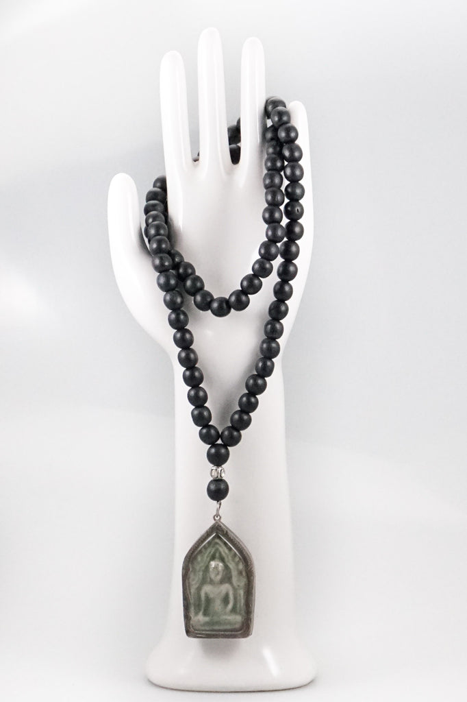 Black Wood Beads Necklace with an Amulet and a Small Polki Diamond Bead