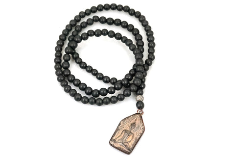 Black Wood Bead Necklace with an Amulet and a Small Polki Diamond Bead