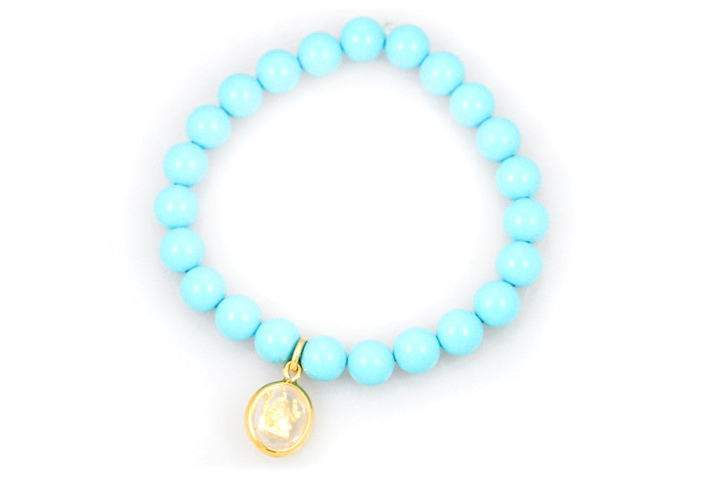 Turquoise Beads with a Small Gold Amulet Charm