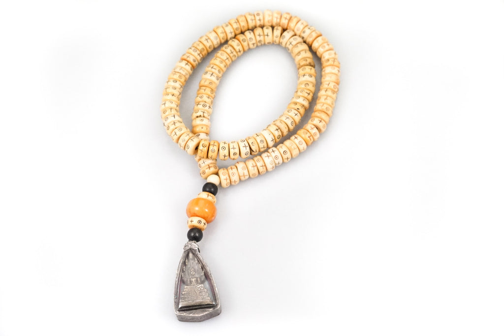 White Tibetan Bone Necklace with an Amulet and an Amber Bead