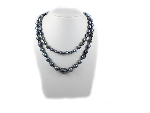 Tahitian Pearls strung together with Macrame and a Extra Large Pave Diamond Bead