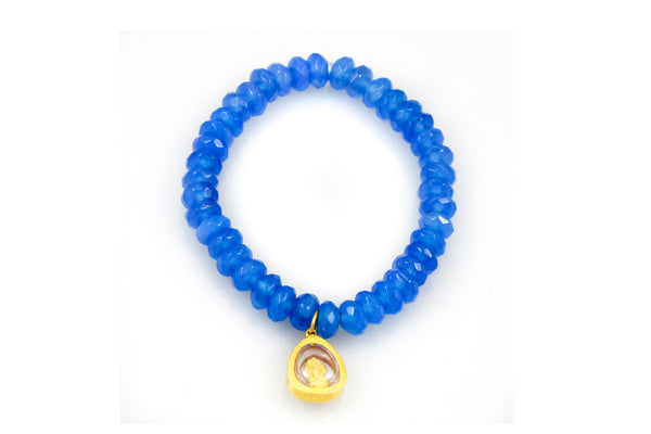 Blue Topaz Beads with a Hanging Gold Charm