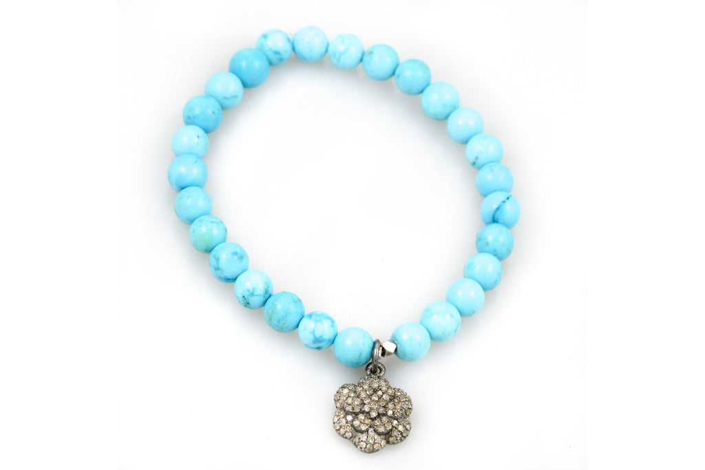 Small Turquoise Beads with a Pave Diamond Charm