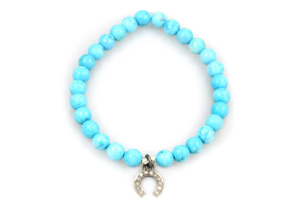 Small Turquoise Beads with a Horseshoe Charm