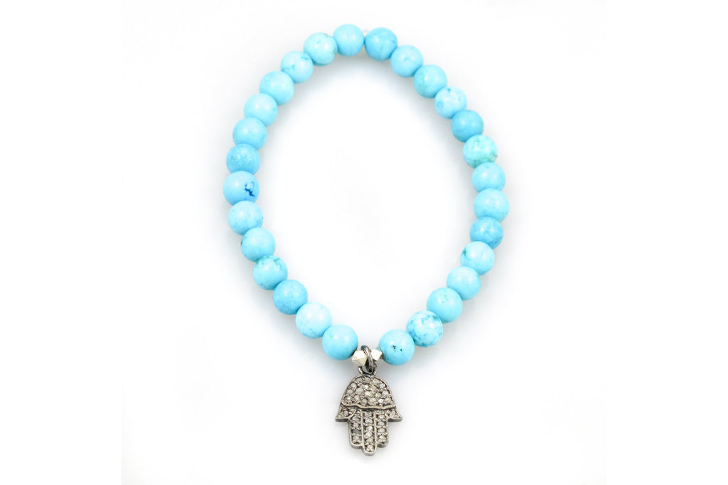 Small Turquoise Beads with a Hand Mudra Charm