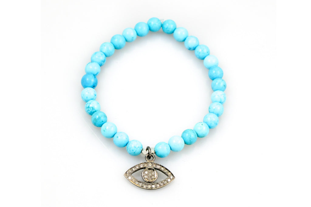 Small Turquoise Beads with a Evil Eye Charm
