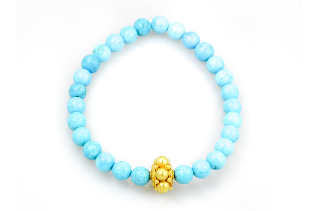Small Turquoise Beads with a Gold Bead