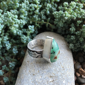 Side view of Chrysoprase Holly Ring, details of stamping and handcut holly leaf size 6.75