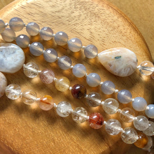 grey moonstone and rutilated quartz close up by Crow Totem Arts