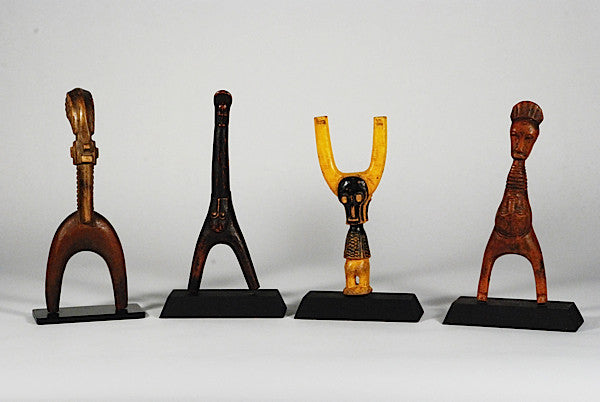 Four exceptional Baule, Ivory Coast, wooden slingshots