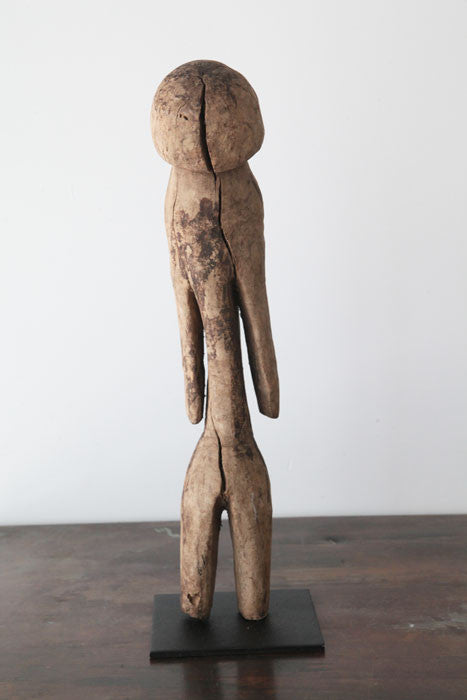 An African Moba figure standing upright
