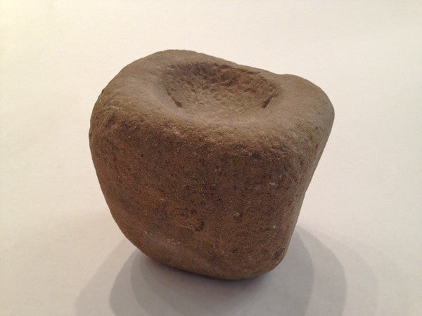 A small Aboriginal stone mortar, with tall shoulders, and shallow bowl
