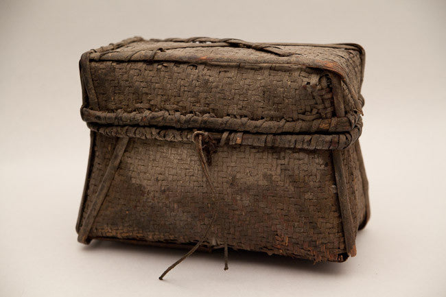 A woven Headhunter's basket with lid