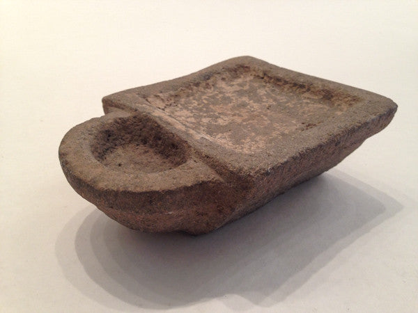 ancient Middle Eastern stone lamp with trapezoidal sides