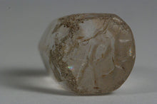 the bottom of a transparent glass stamp from Western Anatolia