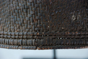 A thickly woven rain hat close up showing tight weaving